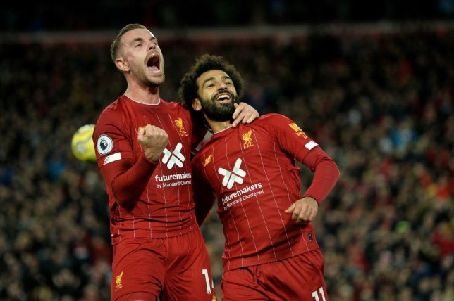 Mohamed Salah and Jordan Henderson of Liverpool
