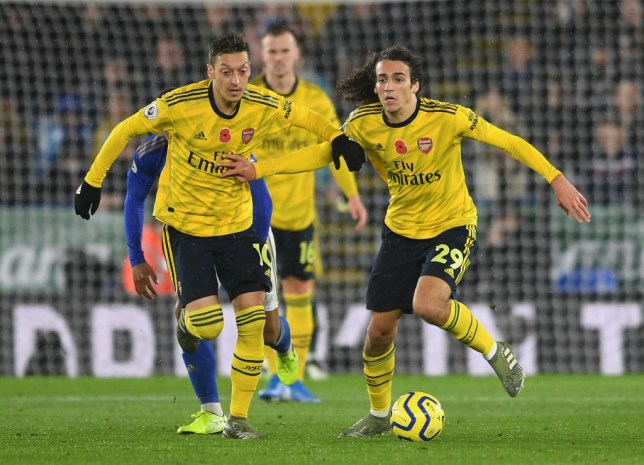 Mesut Ozil and Matteo Guendouzi of Arsenal during the Premier League match between Leicester City and Arsenal FC at The King Power Stadium on November 09, 2019 in Leicester, United Kingdom.