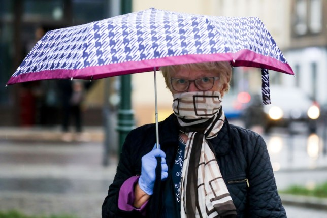 a woman with a scarf and umbrella