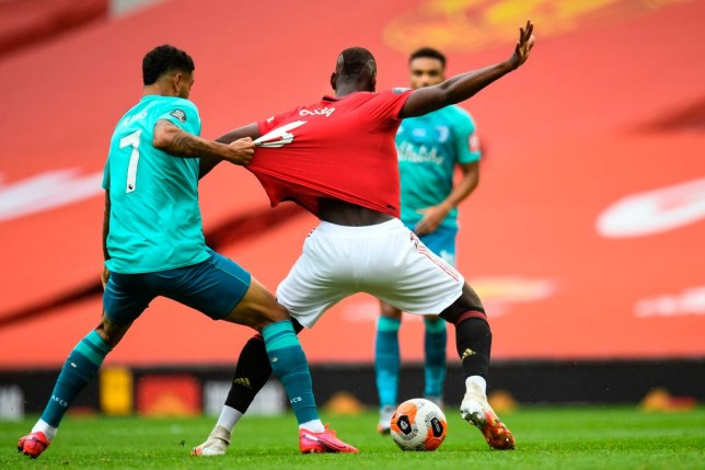 Joshua King pulls the shirt of Paul Pogba in Bournemouth's defeat at Manchester United in the Premier League