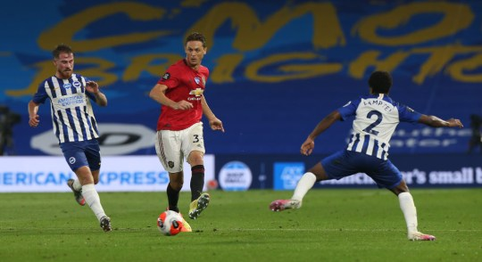 Nemanja Matic of Manchester United in action with Tariq Lamptey of Brighton and Hove Albion during the Premier League match between Brighton & Hove Albion and Manchester United at American Express Community Stadium on June 30, 2020 in Brighton, England.