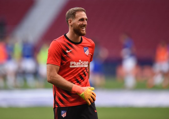Jan Oblak of Atletico Madrid reacts during the warm-up before the start of the La Liga match between Club Atletico de Madrid and Real Sociedad at Wanda Metropolitano on July 19, 2020 in Madrid, Spain. Football stadiums across Europe remain empty due to the coronavirus pandemic as government social distancing laws ban fans inside venues, resulting in all matches being held behind closed doors.