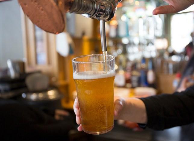 Beer being served in pub.