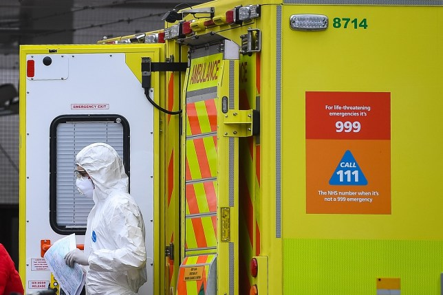 A paramedic wearing personal protective equipment (PPE) exits an ambulance outside St Thomas' Hospital in Westminster, London, as the UK continues in lockdown to help curb the spread of the coronavirus.