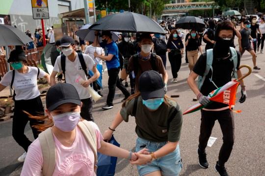 Les manifestants occupent une route à Hong Kong