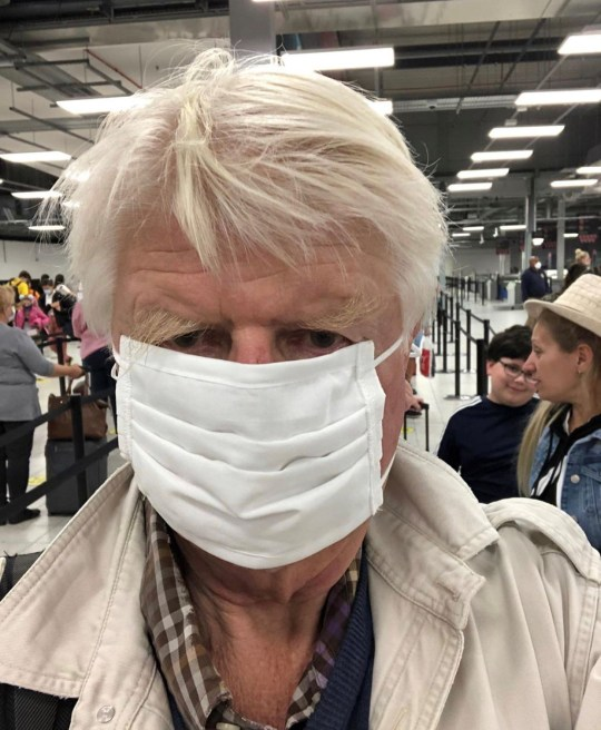 A picture shared on Instagram by Stanley Johnson wearing a face mask at an airport