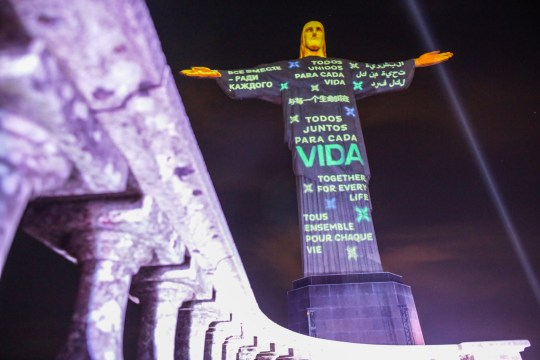 RIO DE JANEIRO, BRAZIL - JULY 01: Messages of solidarity are projected on the statue of Christ the Redeemer as a tribute to victims of the coronavirus (COVID-19) pandemic on on July 1, 2020 in Rio de Janeiro, Brazil. (Photo by Andre Coelho/Getty Images)