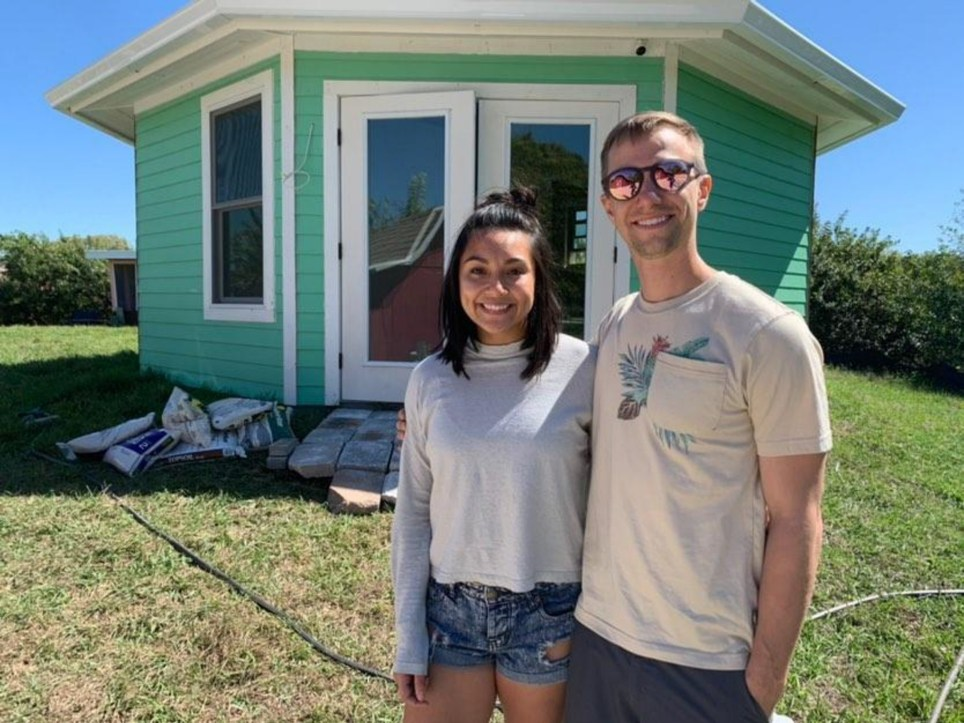 Sam and Tim outside Octagon house, the tiny house they had built on their own peninsula