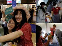 """People who want to leave the island, but cannot due to coronavirus disease-related (COVID-19) travel restrictions, take selfies during the """"fake"""" travel experience for tourists simulating the experience of using an international airport at Songshan airport in Taipei, Taiwan July 2, 2020. REUTERS/Ann Wang"""