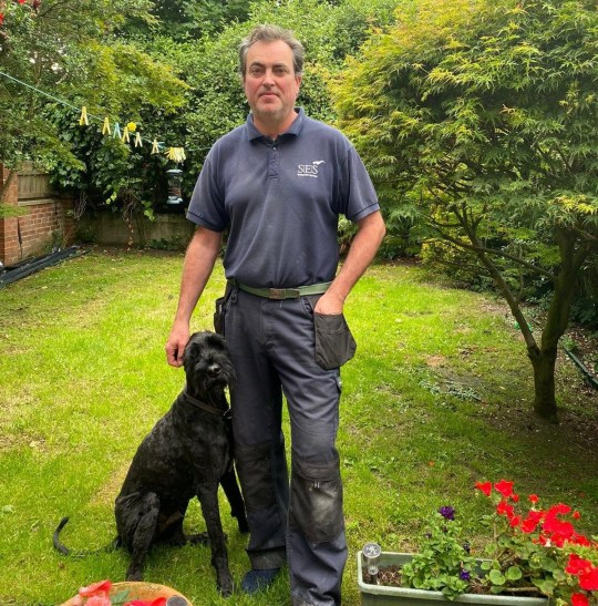 ***EMABARGOED 2PM BST / 9AM EST JULY 3 2020*** Neil Taylor with Alfie the dog. See SWNS story SWOCalfie. A family dog needed a life-saving operation after he swallowed a staggering 26 golf balls while out on walks with his owner. Dad-of-two Neil Taylor, 50 regularly walks Alfie, his 10-year-old giant schnauzer through a golf course near their home. But unbeknown to him, Alfie had been gobbling up stray golf balls during their recent walks. They only found out after Alfie became poorly at his doggy day car - and then proceeded to vomit up four golf balls in Mr Taylor's back garden.