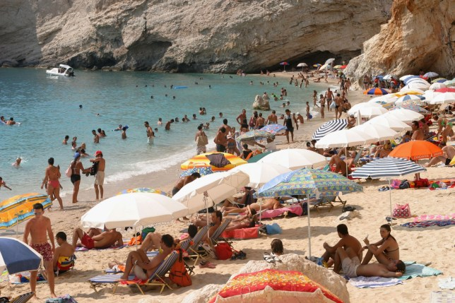 Tourists crowd Porto Katsiki Beach on Lefkada Island in Greece