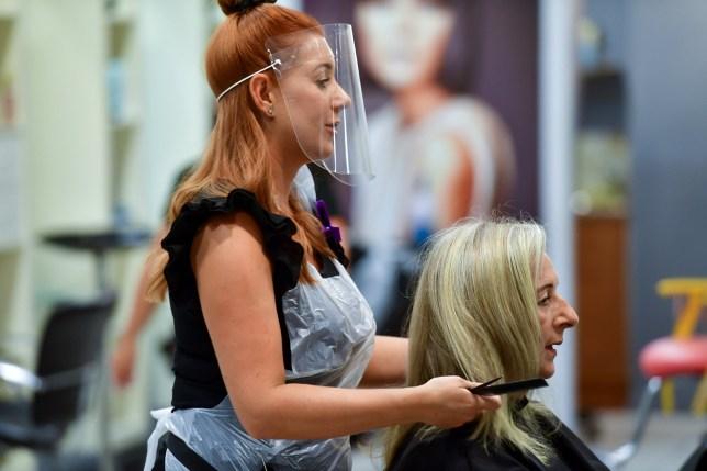 A hairdresser working after lockdown