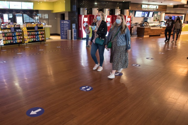 Staff at the Bluewater, Kent Showcase Cinema welcome its first customers when it reopens following the relaxation of coronavirus locking restrictions in England.  Photo PA.  Date of photo: Saturday, July 4, 2020. The easing of restrictions, which was imposed on March 23, allows businesses, including restaurant pubs and hair salons, to reopen to the public with measures in place to prevent the spread coronavirus.  See the story of PA HEALTH Coronavirus.  Photo credit should read: Stefan Rousseau / PA Wire