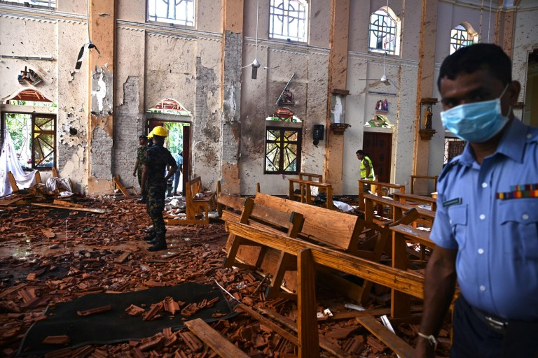 Security personnel inspect the interior of St Sebastian's Church in Negombo on April 22, 2019, a day after the church was hit in series of bomb blasts targeting churches and luxury hotels in Sri Lanka.