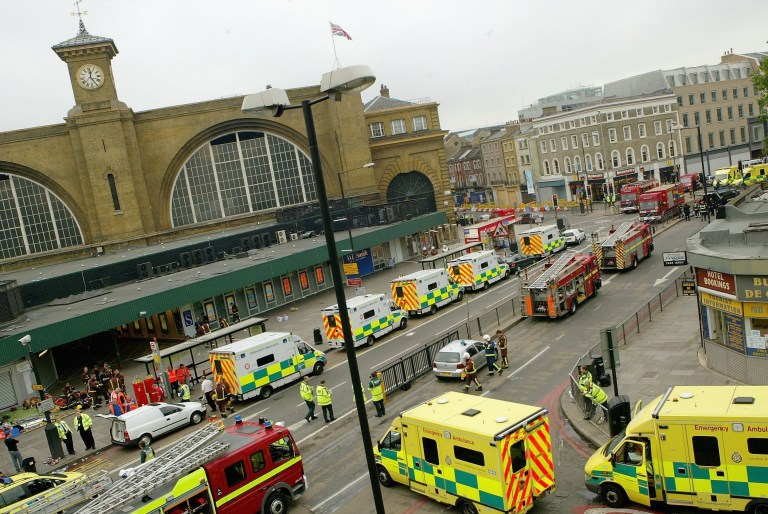 Emergency services are seen outside the main line station at Kings Cross following an explosion which has ripped through London's tube network on July 7, 2005 in London, England.