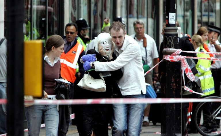 Emergency services assist evacuated passengers at Edgware Road following an explosion which has ripped through London's underground tube network on July 7, 2005 in London, England.