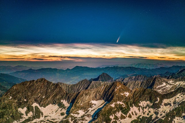 The Neowise comet seen above noctilucent clouds taken from the Hochfeiler mountain in the South Tyrol alps in Italy (Credits: Martin Rietze / SWNS.com)