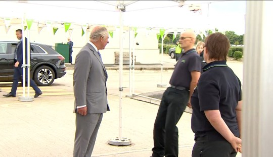 Still of video showing man fainting as he chats to Prince Charles