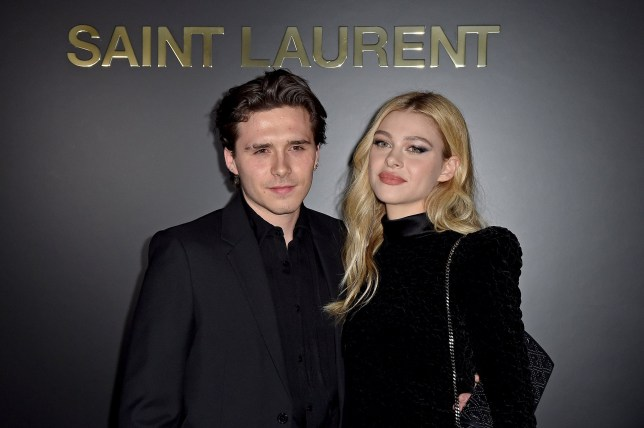 Brooklyn Beckham and Nicola Peltz attends the Saint Laurent show as part of the Paris Fashion Week