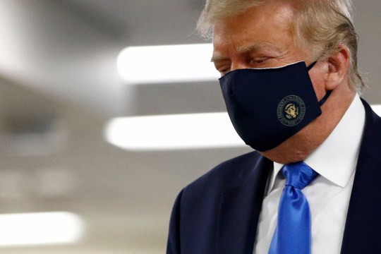 President Donald Trump wears a face mask as he walks down a hall during a visit to the Walter Reed National Military Medical Center in Bethesda, Maryland, Saturday July 11, 2020. (AP Photo / Patrick Semansky)