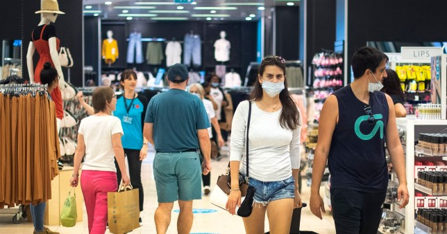 Customers wear face masks as they shop inside Primark as face coverings are to be made mandatory in all English stores.