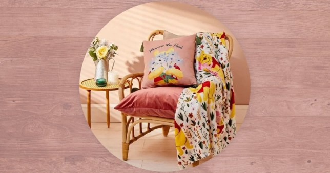 the Winnie the pooh blanket and pillow on a chair