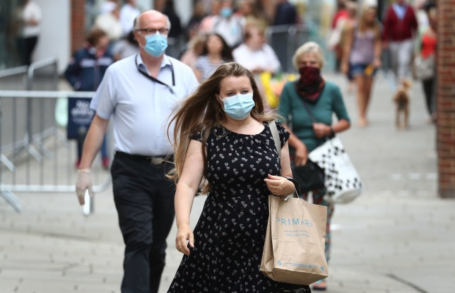 A lady wears a face covering whilst shopping in Canterbury, Kent, ahead of the announcement that it will soon be mandatory to wear a face covering in shops in England. PA Photo. Picture date: Tuesday July 14, 2020. Health Secretary Matt Hancock will announce today that from July 24 wearing a face covering in shops and supermarkets will be mandatory, and anyone failing to comply with the order could face a fine of up to ?100. Enforcement of the regulations will be the responsibility of the police. See PA story HEALTH CoronavirusFaceMasks. Photo credit should read: Gareth Fuller/PA Wire