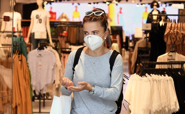 A customer wearing a face mask at a store in London