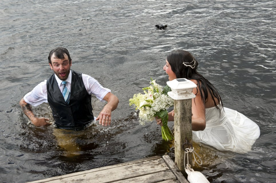 bride Lora Wendorf and groom Jordan Devries took a tumble into the river while posing for their wedding snaps