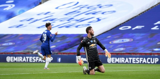 Chelsea's Mason Mountcelebrates scoring his side's second goal of the game as Manchester United goalkeeper David de Gea looks on after his mistake during the FA Cup Semi-Final match at Wembley