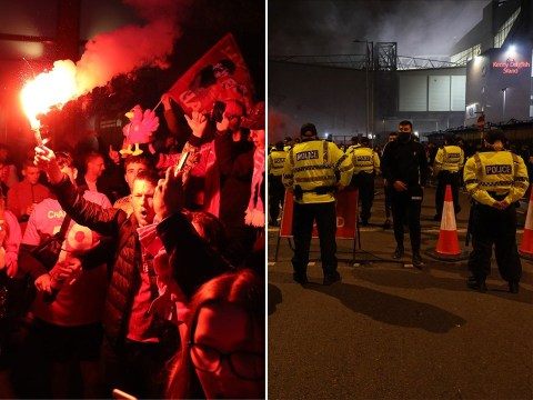 Liverpool fans dispersed by police after they celebrate in the street