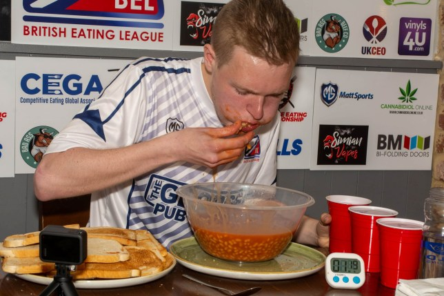 The beans and toast eating challenge at George Pub and Grill in Stockton-on-Tees. See SWNS copy SWSYbeans: This footage shows Britain's first beans on toast eating competition - where entrants race to consume 20 slices of toast and 2.5kg of beans in the shortest time. Organiser Craig Harker, 33, was inspired to bring competitive eating to the UK by the American TV show Man v. Food. He hosts challenges at venues around the country, including his own pub, the George Pub and Grill in Stockton-on-Tees.