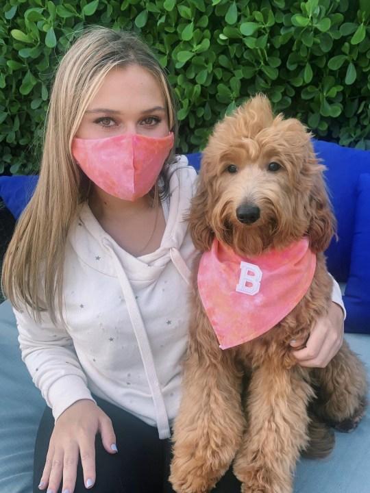 woman and dog wearing bandana and face mask