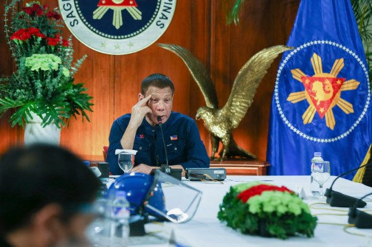 In this photo provided by the Malacanang Presidential Photographers Division, Philippine President Rodrigo Duterte talks to members of the Inter-Agency Task Force on the Emerging Infectious Diseases at the Malacanang presidential palace in Manila, Philippines Thursday, July 30, 2020. (Simeon Celi Jr./ Malacanang Presidential Photographers Division via AP)