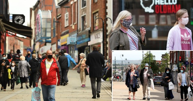 Shoppers wearing facemasks walk through central Rochdale, greater Manchester, northwest England on July 30, 2020. - Rochdale reportedly faces harsher lockdown measures being imposed after a spike in coronavirus cases. (Photo by Oli SCARFF / AFP) (Photo by OLI SCARFF/AFP via Getty Images)