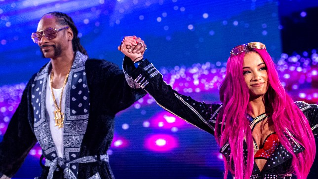 Snoop Dogg with WWE superstar and cousin Sasha Banks at WrestleMania 32