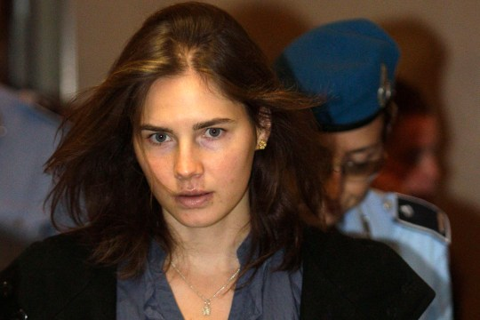 Amanda Knox (L), the U.S. student convicted of murdering her British flatmate Meredith Kercher in Italy in November 2007, arrives at the court during her appeal trial session in Perugia, Italy on September 30, 2011. A Florence court handed down guilty verdicts for U.S. student Amanda Knox and her former Italian boyfriend Raffaele Sollecito on January 30, 2014 in a retrial for the 2007 murder of Briton Meredith Kercher, reversing an acquittal by a previous appeal ruling. REUTERS/Alessandro Bianchi/Files (ITALY - Tags: CRIME LAW)