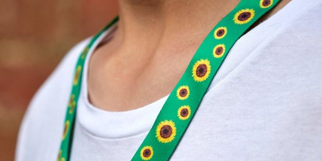 a person wearing a sunflower lanyard