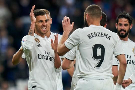 Dani Ceballos and Karim Benzema celebrate during Real Madrid's clash with SD Huesca