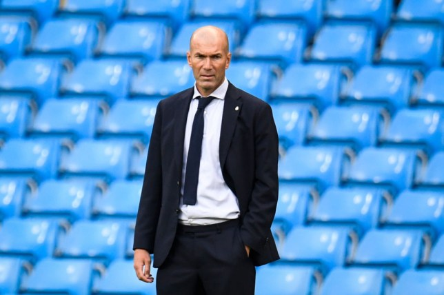 Real Madrid's French coach Zinedine Zidane reactsduring the UEFA Champions League round of 16 second leg football match between Manchester City and Real Madrid at the Etihad Stadium in Manchester, north west England on August 7, 2020.