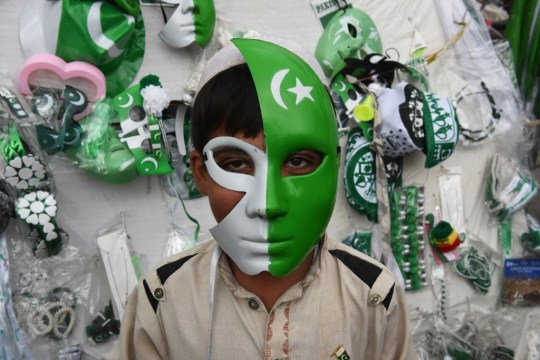 Person wearing green and white mask