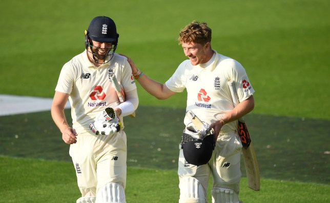 Chris Woakes and Dom Bess look on after England's Test victory over Pakistan