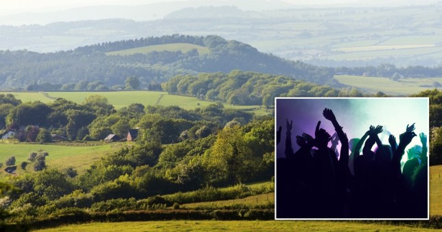 Police work to break up rave in the Forest of Dean.