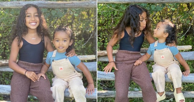 North West and Chicago West posing on a fence in the garden