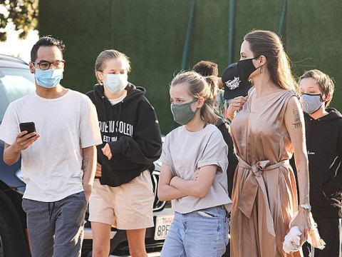 Glam Angelina Jolie and kids mask up as they treat themselves on family sushi date