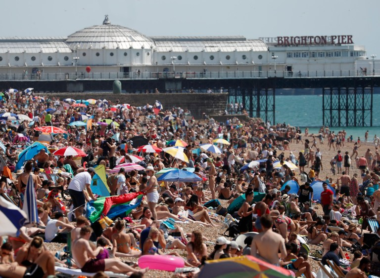 Beachgoers are soaking up the sun and the sea on what is now the hottest day of the year in Britain so far, in Brighton, England on Friday July 31, 2020. Temperatures reached 35 ° C (95 ° F) at London's Heathrow Airport. (AP Photo / Alastair Grant)