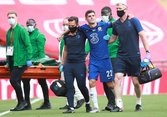 Chelsea's US midfielder Christian Pulisic (3R) leaves the pitch injured during the English FA Cup final football match between Arsenal and Chelsea at Wembley Stadium in London, on August 1, 2020. (Photo by Adam Davy / POOL / AFP) / NOT FOR MARKETING OR ADVERTISING USE / RESTRICTED TO EDITORIAL USE (Photo by ADAM DAVY/POOL/AFP via Getty Images)