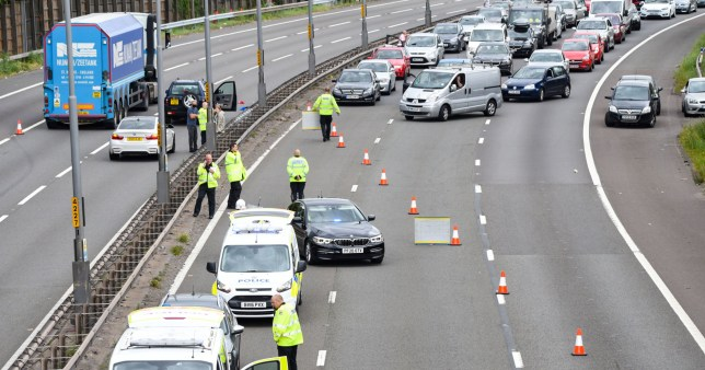 **Number plates may need pixelating/Moving Footage with relevant desk** Pic by SnapperSK - (Pictured:: PICTURED 5/7/20 west midlands police collision investigators on the M5 motorway in the West Midlands after a boy believed to be aged 12 - 13 is seen running into on coming traffic. The child has been it by multiple vehicles and he is described as being in a critical condition. Police can be seen removing the childs mountain bike and cycle helmet from the scene where he left it in bushes. ENDS