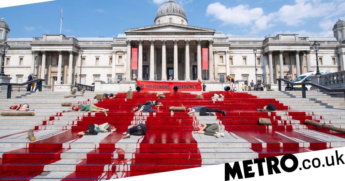 Extinction Rebellion protesters cover Trafalgar Square in fake blood