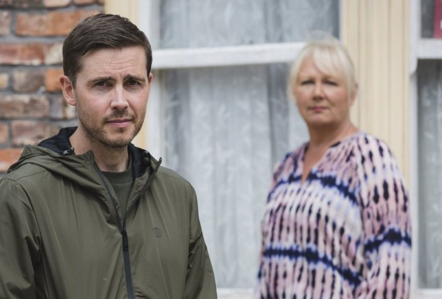 Undated handout photo issued by ITV of Gareth Pierce (centre), who will play the new Todd Grimshaw as he returns to the Cobbles. PA Photo. Issue date: Monday August 10, 2020. Gareth Pierce will be replacing Bruno Langley who played the role for 16 years. See PA story SHOWBIZ Grimshaw. Photo credit should read: Mark Bruce/ITV/PA Wire NOTE TO EDITORS: This handout photo may only be used in for editorial reporting purposes for the contemporaneous illustration of events, things or the people in the image or facts mentioned in the caption. Reuse of the picture may require further permission from the copyright holder.